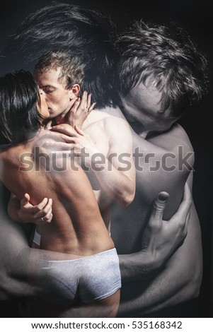 Kissing couple portrait. young beautiful cute lovers in love pretty girl and sexi man. Erotic moments.