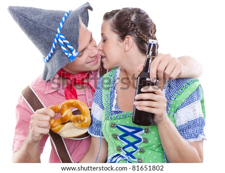 kissing each other at octoberfest - stock photo