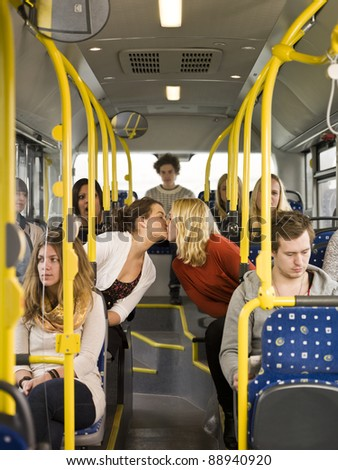 Kissing women on the bus - stock photo