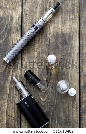 Kit for healthy smoking on wooden table, from above - stock photo