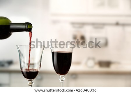 kitchen and two glasses of wine
