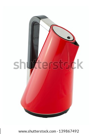 Kitchen appliances - an electric kettle of red color, isolated on a white background - stock photo