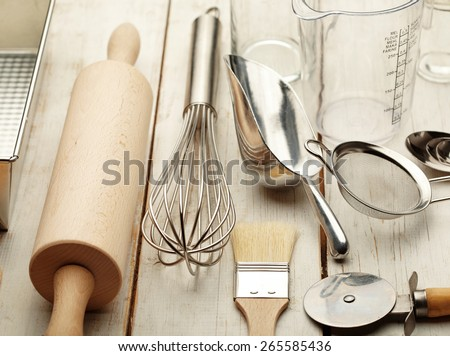 Kitchen baking utensils against white desk - stock photo