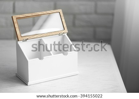 Kitchen box for coffee and sugar with sign on wooden table, closeup
