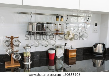 Kitchen cabinets with coffee corner in modern home living room. - stock photo