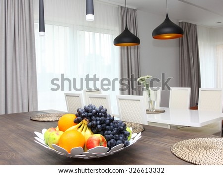 Kitchen connected with dining and living rooms - stock photo