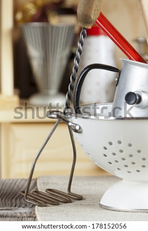 Kitchen cooking utensils are standing on a Table