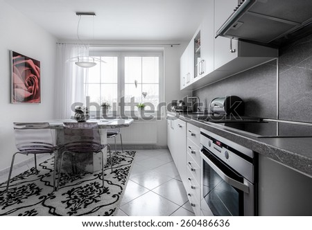 Kitchen currently at home with classical style, decorated in white with marble fittings 2 - stock photo