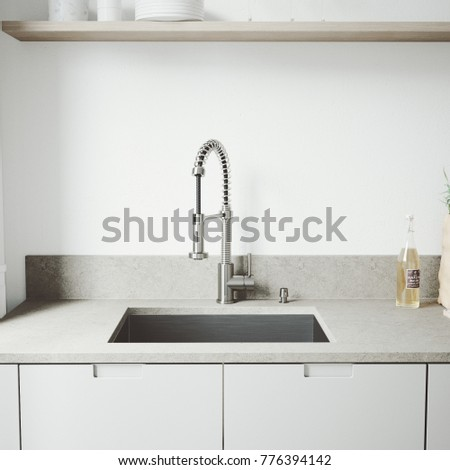 Kitchen Designer Tap With Washbasin In White Background