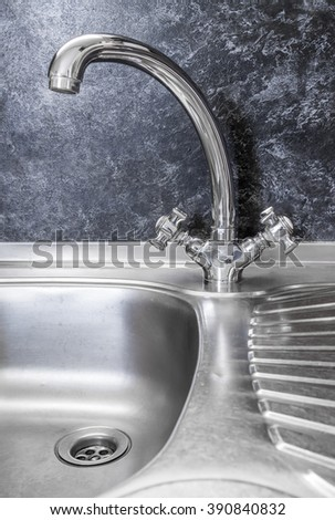 Kitchen Faucet With Swirl Logo