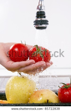 Kitchen faucet, wash your fruits and vegetables. - stock photo