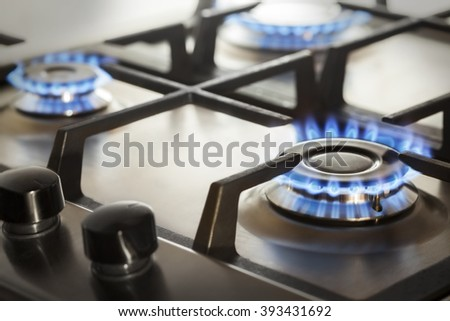 kitchen gas cooker with burning fire propane gas - stock photo