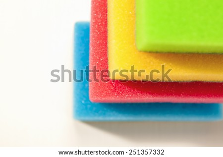 Kitchen Houseware and Utensils Concept: Colorful Sponges in One Stack Together. On a White Surface. Horizontal Image - stock photo