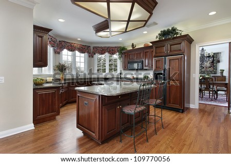 Kitchen in contemporary home with granite counters - stock photo