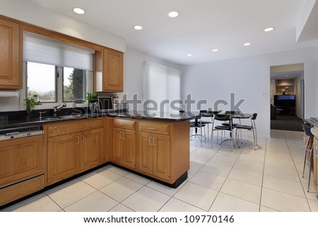 Kitchen in contemporary home with large eating area - stock photo