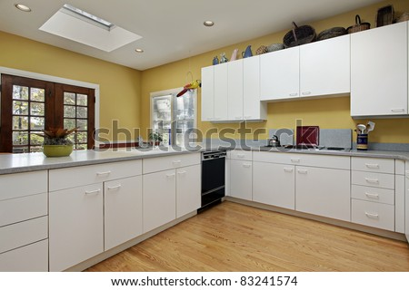 Kitchen in home with skylight near eating area