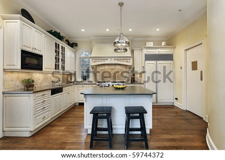 Kitchen in luxury home with decorative oven back splash - stock photo