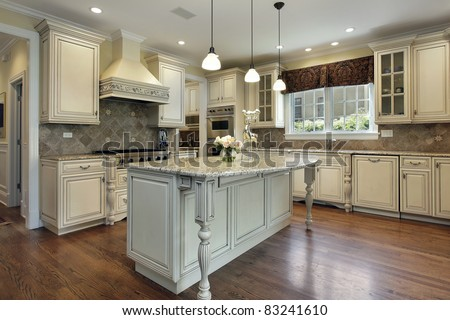 Kitchen in luxury home with large granite island - stock photo
