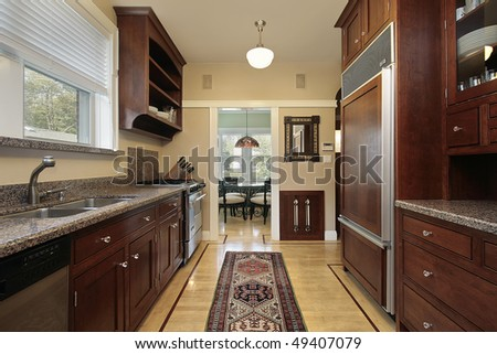 Kitchen in luxury home with wood paneled refrigerator