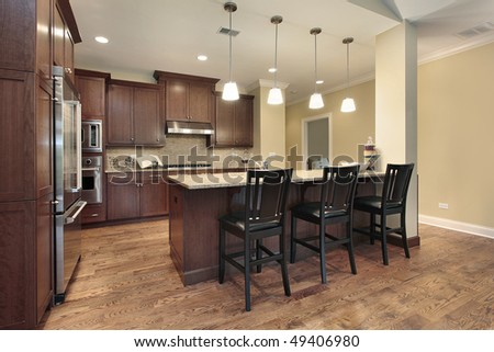 Kitchen in luxury town home with breakfast bar - stock photo