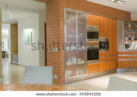 Kitchen in modern design with expensive euqipment - stock photo