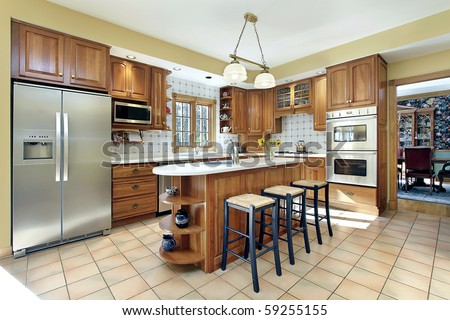 Kitchen in modern home with oak cabinetry - stock photo