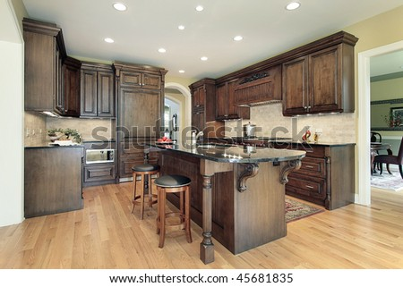 Kitchen in new construction home with granite island top