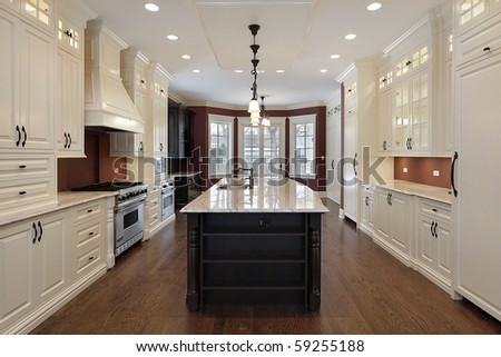 Kitchen in new construction home with large center island - stock photo