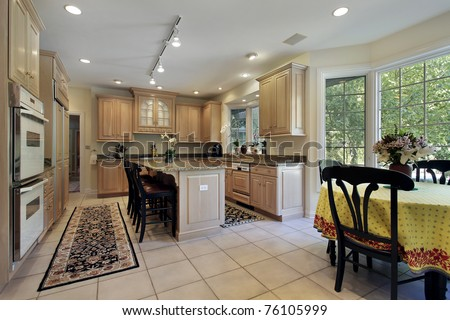Kitchen in suburban home with eating area - stock photo