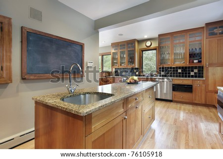 Kitchen in suburban home with glass cabinets