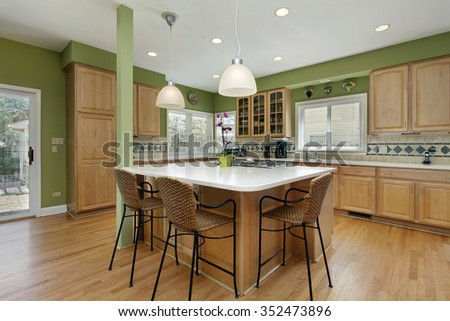 Kitchen in upscale home with oak wood cabinetry - stock photo