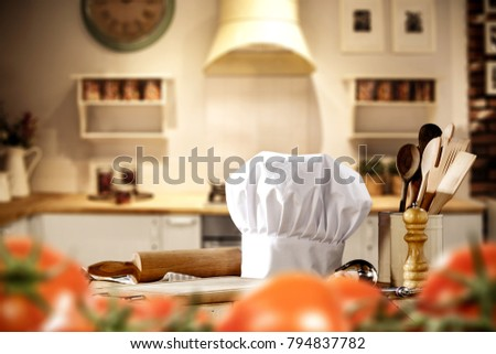 Kitchen interior and cook hat on top. Free space for your decoration