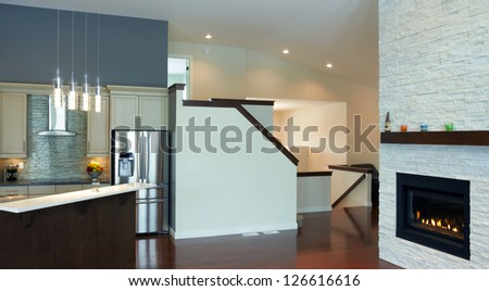 Kitchen interior design with fireplace in a new house - stock photo