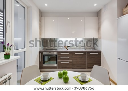 Kitchen interior in a new modern apartment in scandinavian style - stock photo