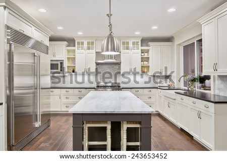 kitchen interior in new luxury home - stock photo