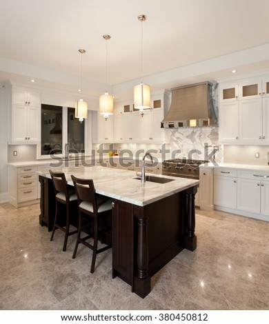 Kitchen interior in new luxury house - stock photo
