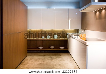 Kitchen interior in white and brown colors - stock photo
