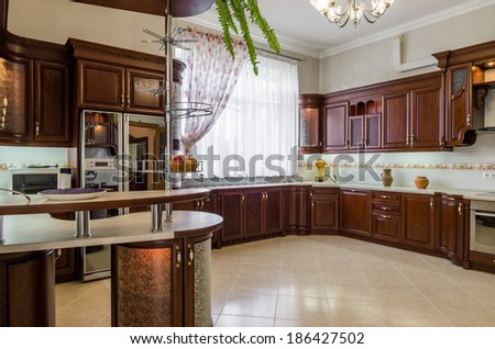 Kitchen interior of wood with breakfast bar - stock photo