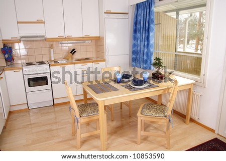 Kitchen interior with asian style decorated table - stock photo