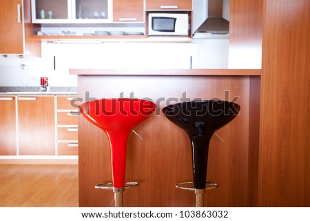 kitchen interior with bar chairs in the apartment - stock photo