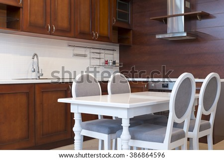 Kitchen interior with dining table - stock photo