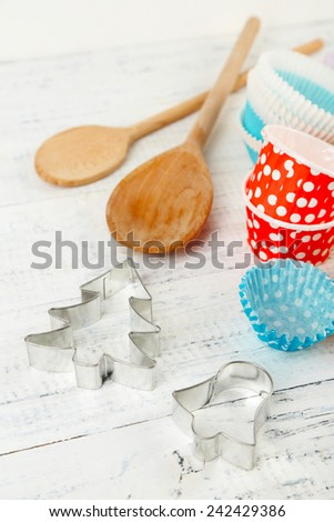 Kitchen molds for baking on color wooden background - stock photo