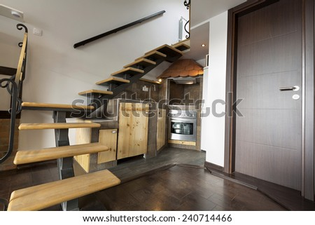 Kitchen packaged under the stairs - stock photo