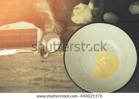 kitchen pots and eggs on wooden table