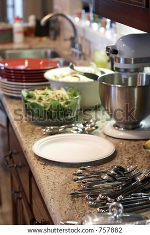 Kitchen prepared to start serving dinner - stock photo