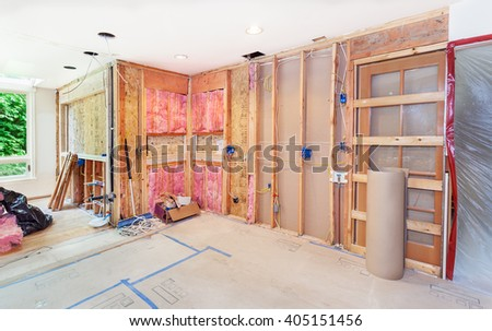 Kitchen remodel gets back to the studs as new windows are framed and new electrical and plumbing are roughed in - stock photo