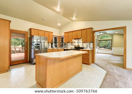 Kitchen room interior in the horse ranch with vaulted ceiling, wooden flat paneled cabinets and mosaic tile floor. Northwest, USA