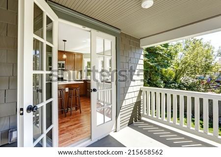 Kitchen room with exit to walkout deck with railings. - stock photo