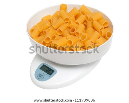 kitchen scale to be weighed with pasta - stock photo