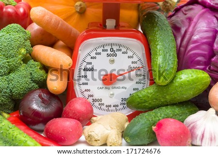 Kitchen scales and fresh vegetables close-up. horizontal photo. - stock photo